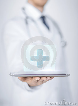 Male doctor holding tablet pc with medical app