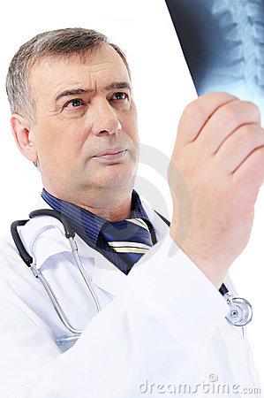 Male doctor holding the X-ray