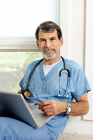 Male Doctor with Laptop Portrait