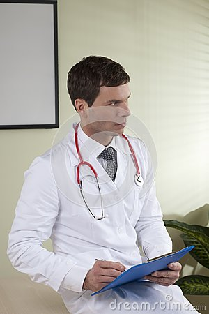 Male doctor with paperwork