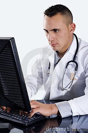 Male Doctor typing on computer