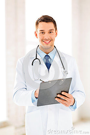 Male doctor writing prescription