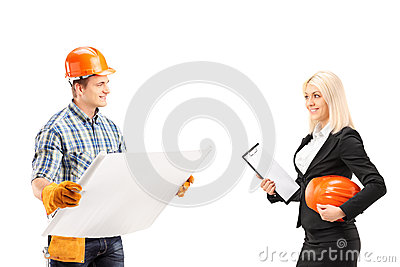 Male engineer holding a blueprint and discuss with female archit