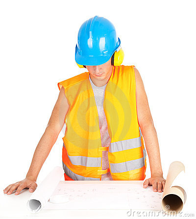 Male engineer looking at blueprints