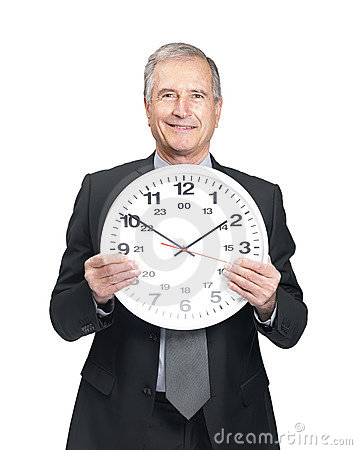 Male entrepreneur holding a wall clock