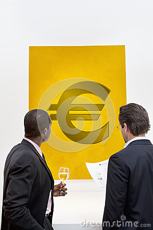 Male executive looking at Euro sign over white background