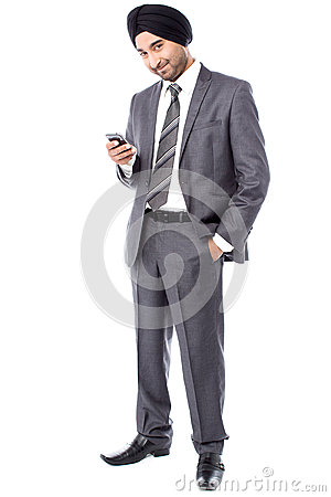 Male executive sending text message