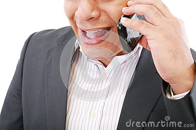 Male executive yelling on his mobile phone