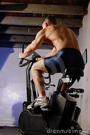 Male on exercise bike