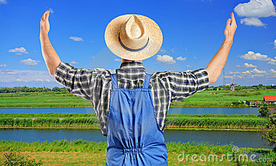 Male farmer gesturing with raised hands