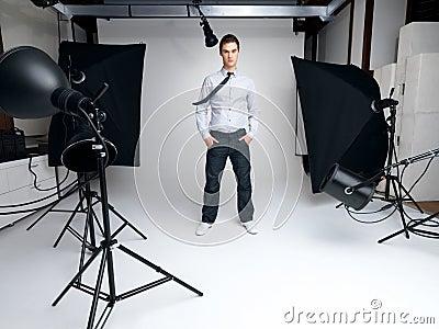 Male fashion model standing in his studio