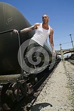 Male fashion model on train