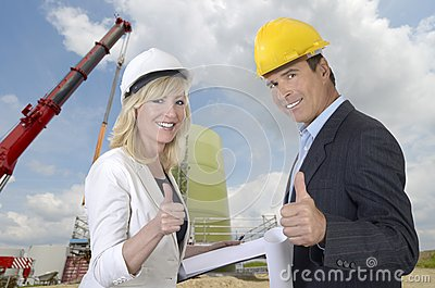 Male and female architect and construction site