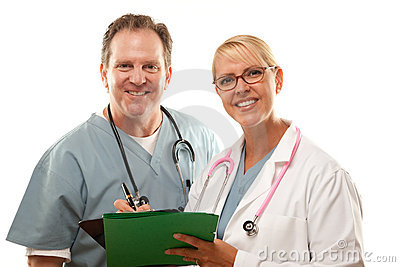 Male and Female Doctors Looking Over Files