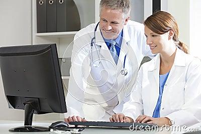 Male Female Hospital Doctors Using Computer