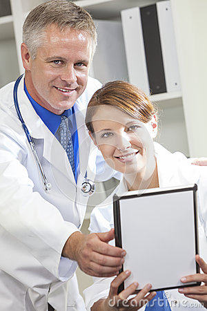 Male Female Hospital Doctors Using Tablet Computer