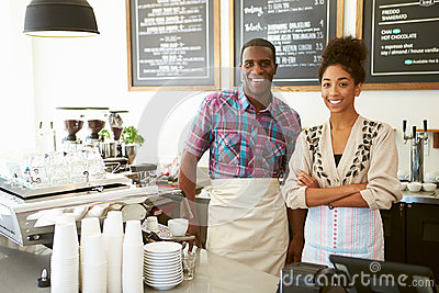 Male And Female Owner Of Coffee Shop