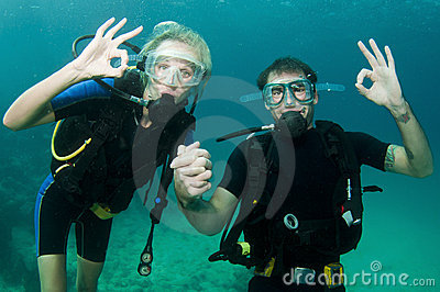 Male and female scuba dive together