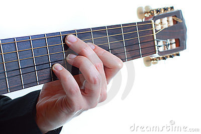 Male fingers playing the guitar