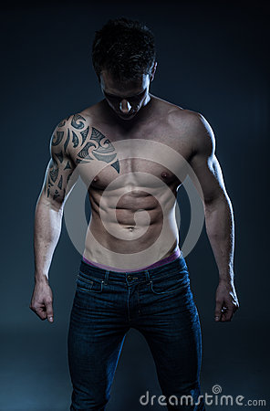 Free Male Fitness Model With The Tattoo Stock Image - 64536971