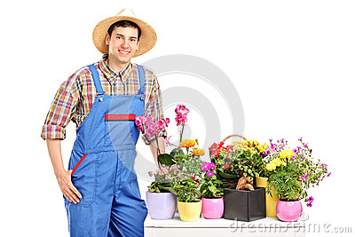 A male florist posing next to flowers