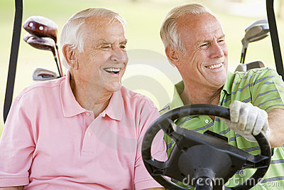 Male Friends Enjoying A Game Of Golf