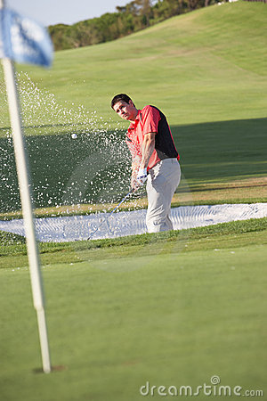 Male Golfer Playing Bunker Shot