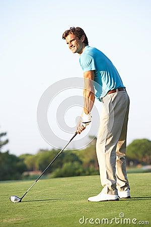 Male Golfer Teeing Off