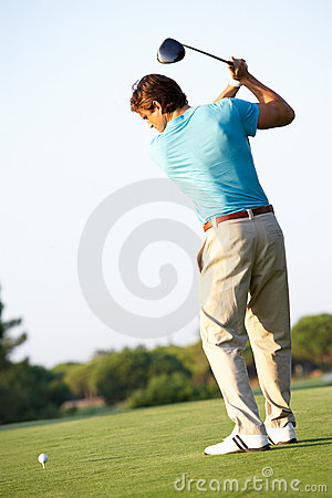 Male Golfer Teeing Off