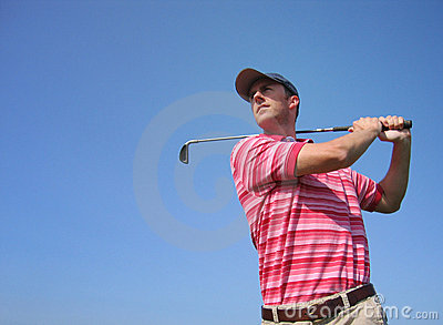 Male Golfer Tees Off