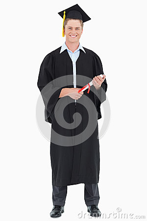 A male graduate with his degree in hand