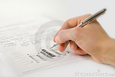 Male hand with business charts and bar graph