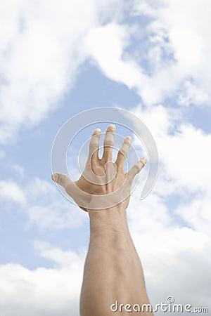 Male Hand Extended Toward Sky