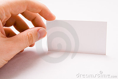 Male hand holding blank business card