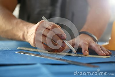 Male hand holding pencil in hand. Stock Photo
