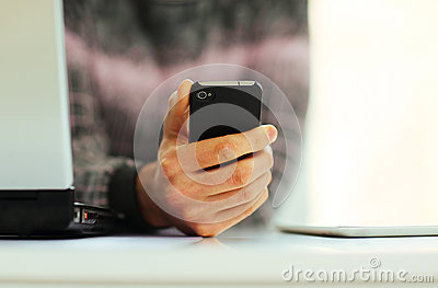 Male hand holding smartphone