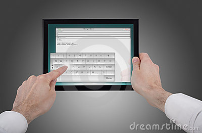 Male hand holding a touchpad pc writing an e-mail