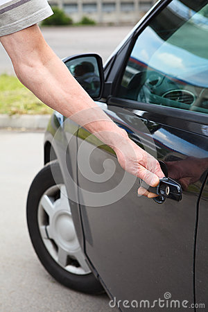 Male hand opening car door