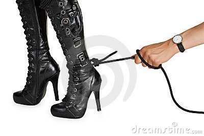 Male hand pulling a rope tied to female leg