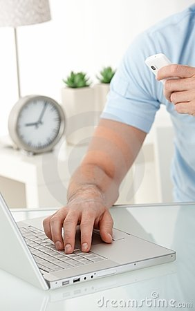 Male hand typing on laptop computer