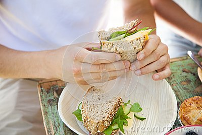 Male hands holding a sandwich