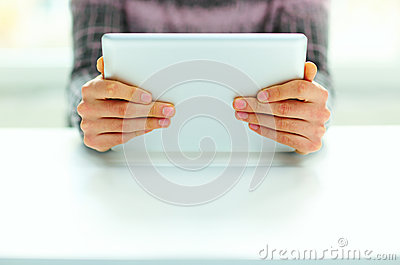 Male hands holding tablet computer