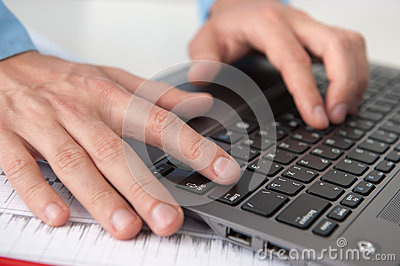 Male hands with laptop