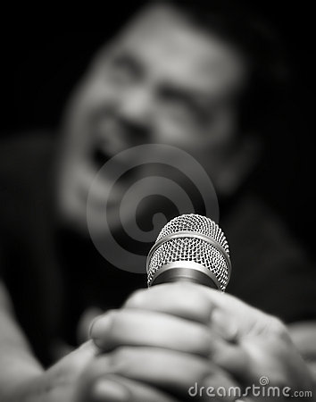 Male Heavy Metal Singer Screams into Microphone