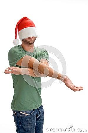 Male hiding his face with santa cap