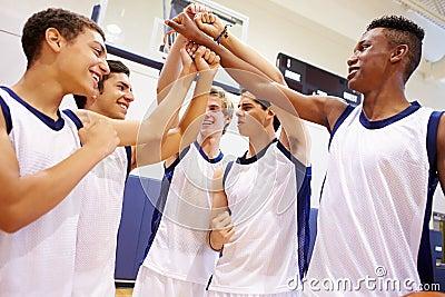 Male High School Basketball Team Having Team Talk