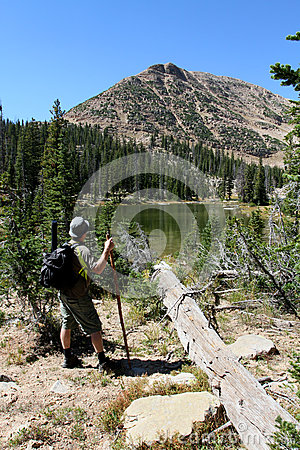 Male hiker by river
