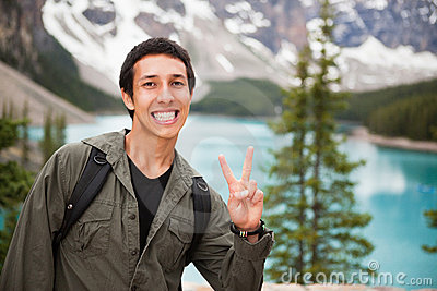 Male hiker showing you the  V  sign