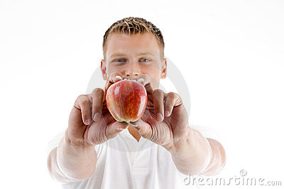 Male holding apple with both hands