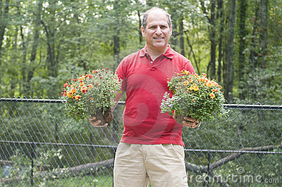 Male homeowner gardening flowers outdoors